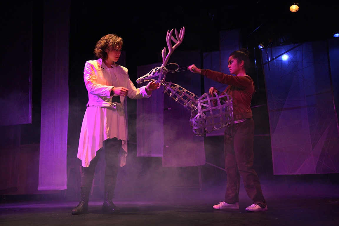 "Two actors performing at Theater Mu, ""Purple Cloud."""