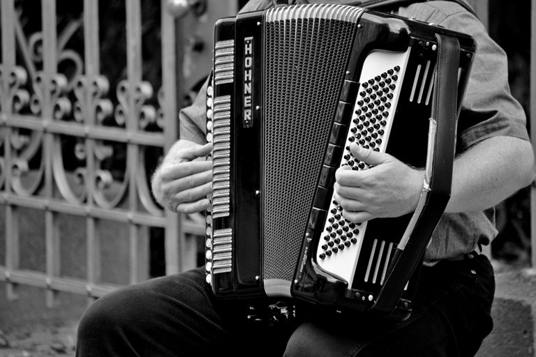 A man holding an accordian.