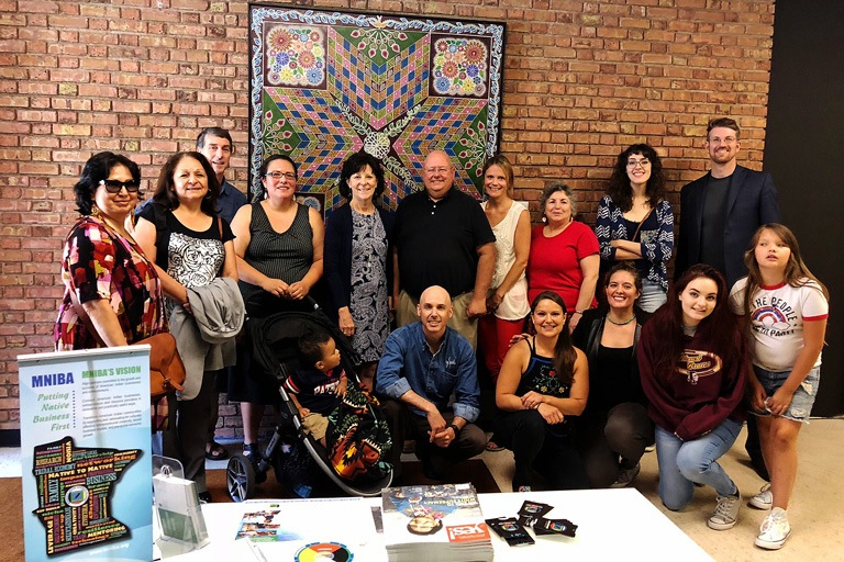 Group of people posed at the Minnesota Indian Business Alliance Quarterly Meeting at the American Indian Community Housing Organization.