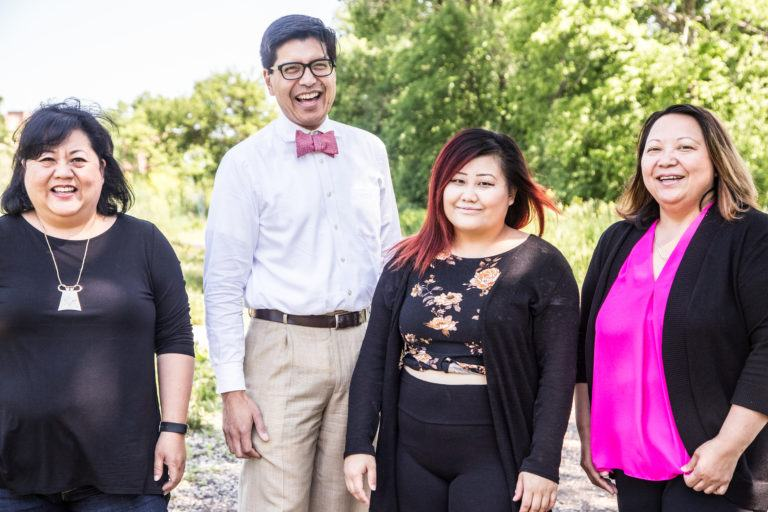Four staff members of Coalition of Asian American Leaders standing at Frogtown Farms.