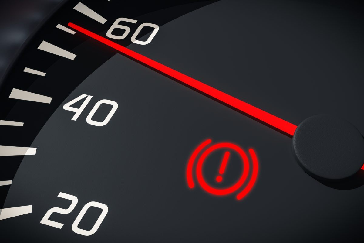 Brake system warning light in car dashboard. 3D rendered illustration. Close up view.