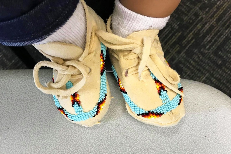 baby feet with moccasins