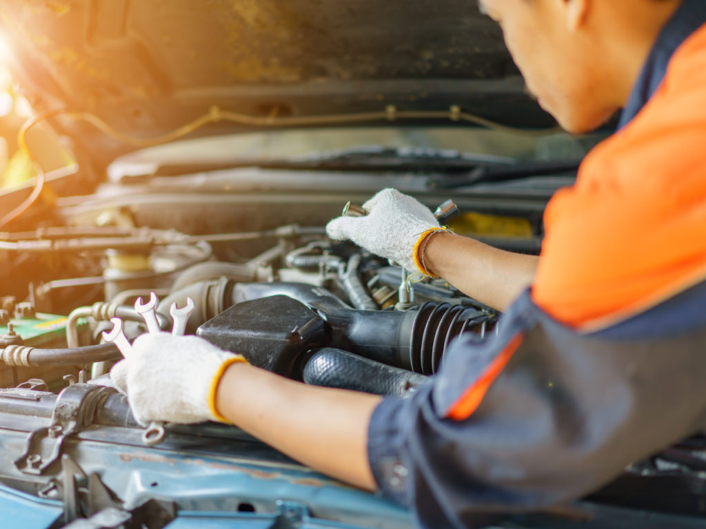 Auto mechanic Preparing For the work. Mechanic with Stainless Steel Wrench in Hand.Close up of hands mechanic doing car service and maintenance.