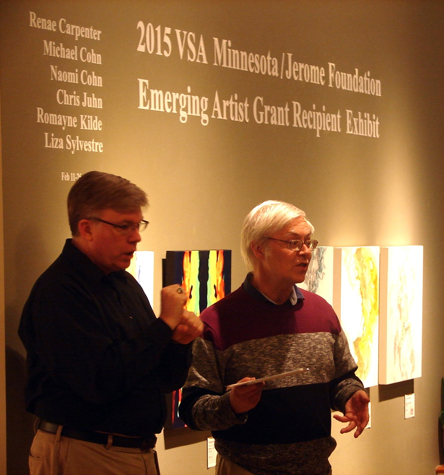 Jon Skaalen of VSA Minnesota and interpreter at Homewood Studios in north Minneapolis for the 2015 Emerging Artist Grant recipient exhibit
