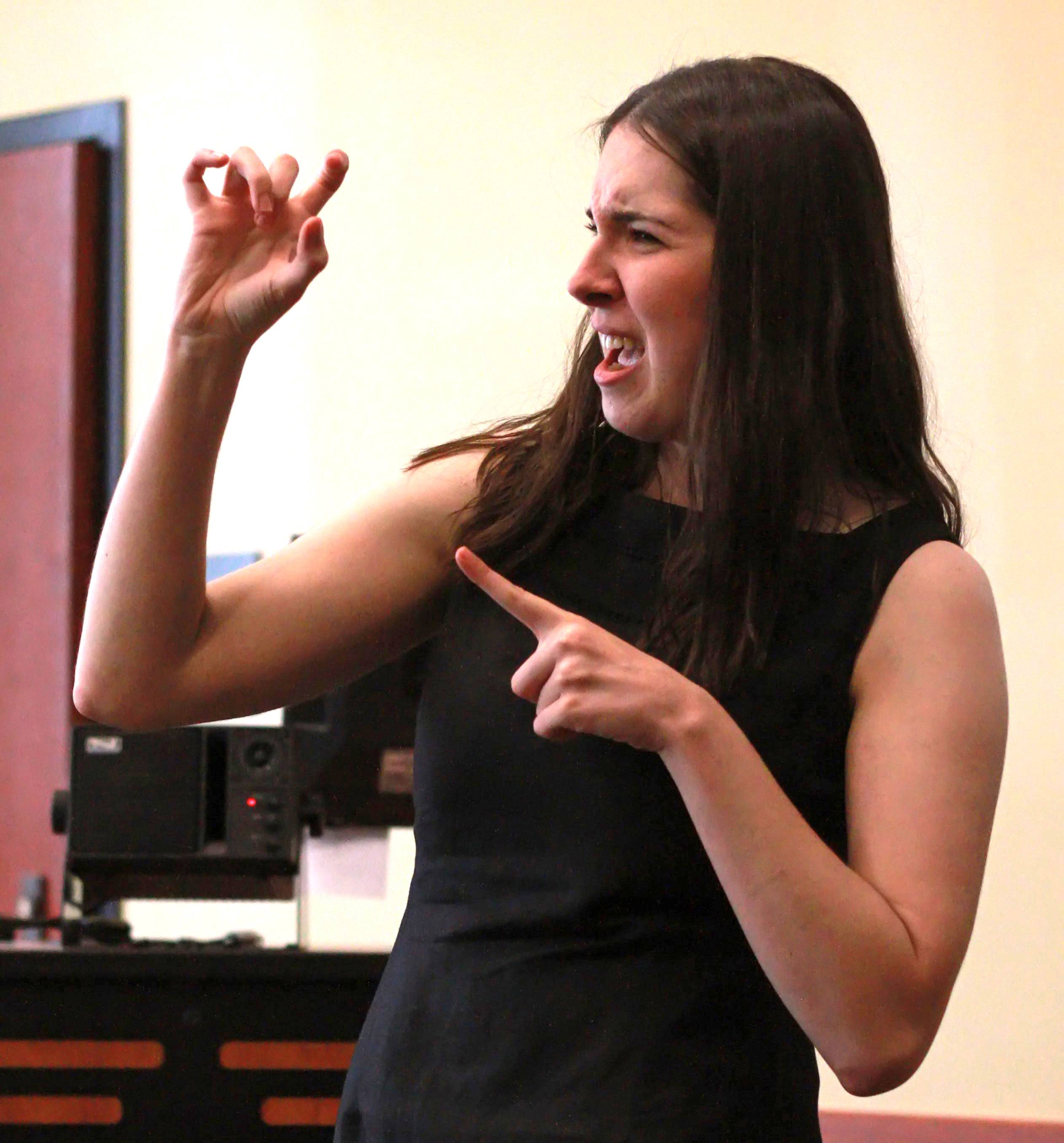 Kaitlyn Mielke performing Defying Gravity (from Wicked) in American Sign Language at the celebration of the 22nd anniversary of the passage of the Americans with Disabilities at a community event in Minneapolis