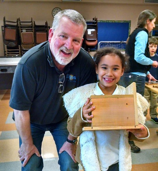 Paul and little girl holding a nesting box