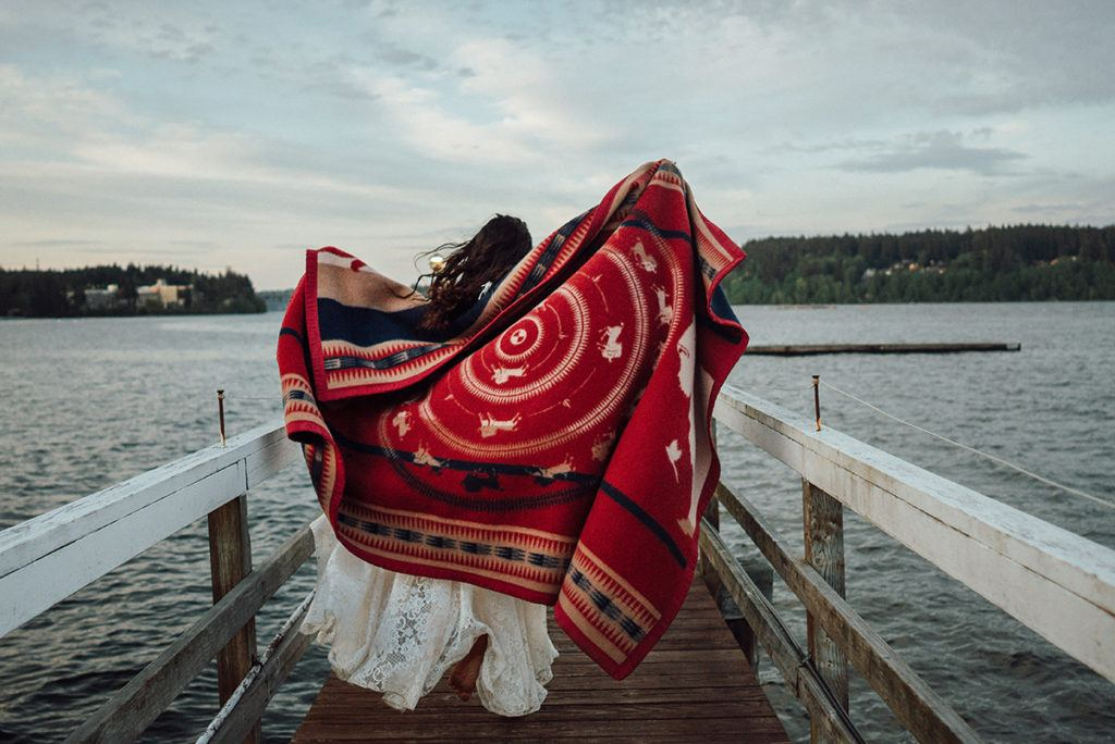 Woman on dock with blanket