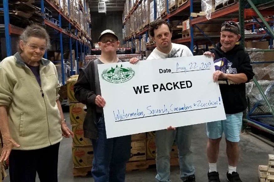 Itasca Life Options clients in warehouse