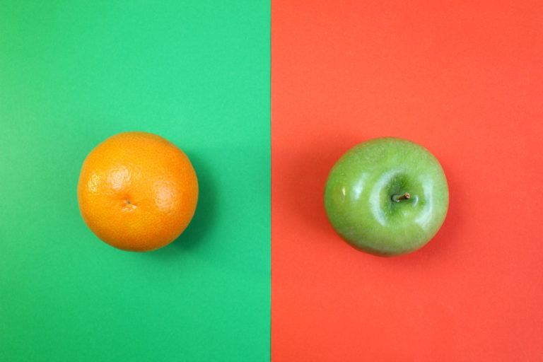 An orange on a green background next to an apple on a red background