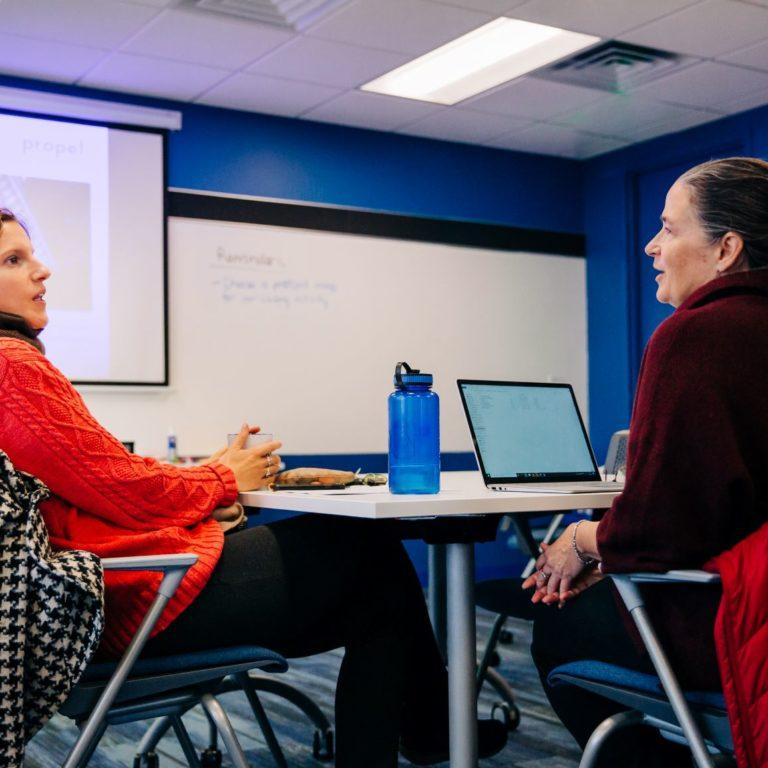 two people talking during a cohort session