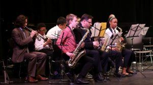 Students play instruments during a concert