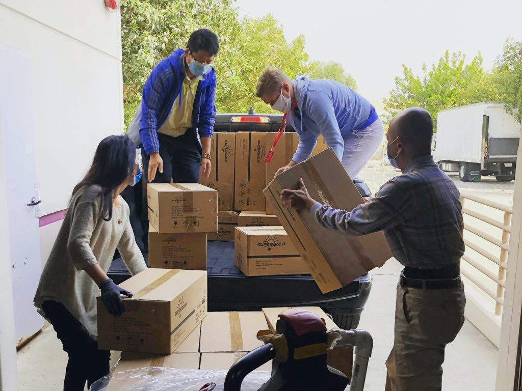 volunteers moving boxes onto a truck bed